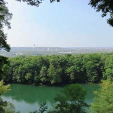 Rheinsteig Stage 1 - View on the blue lake in Oberkassel with Bonn in the background